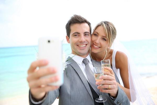 married couple taking selfie