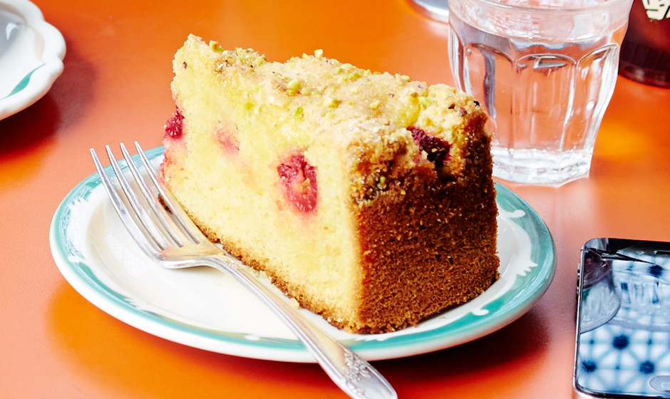 lemon cake with raspberries and pistachios 940x560