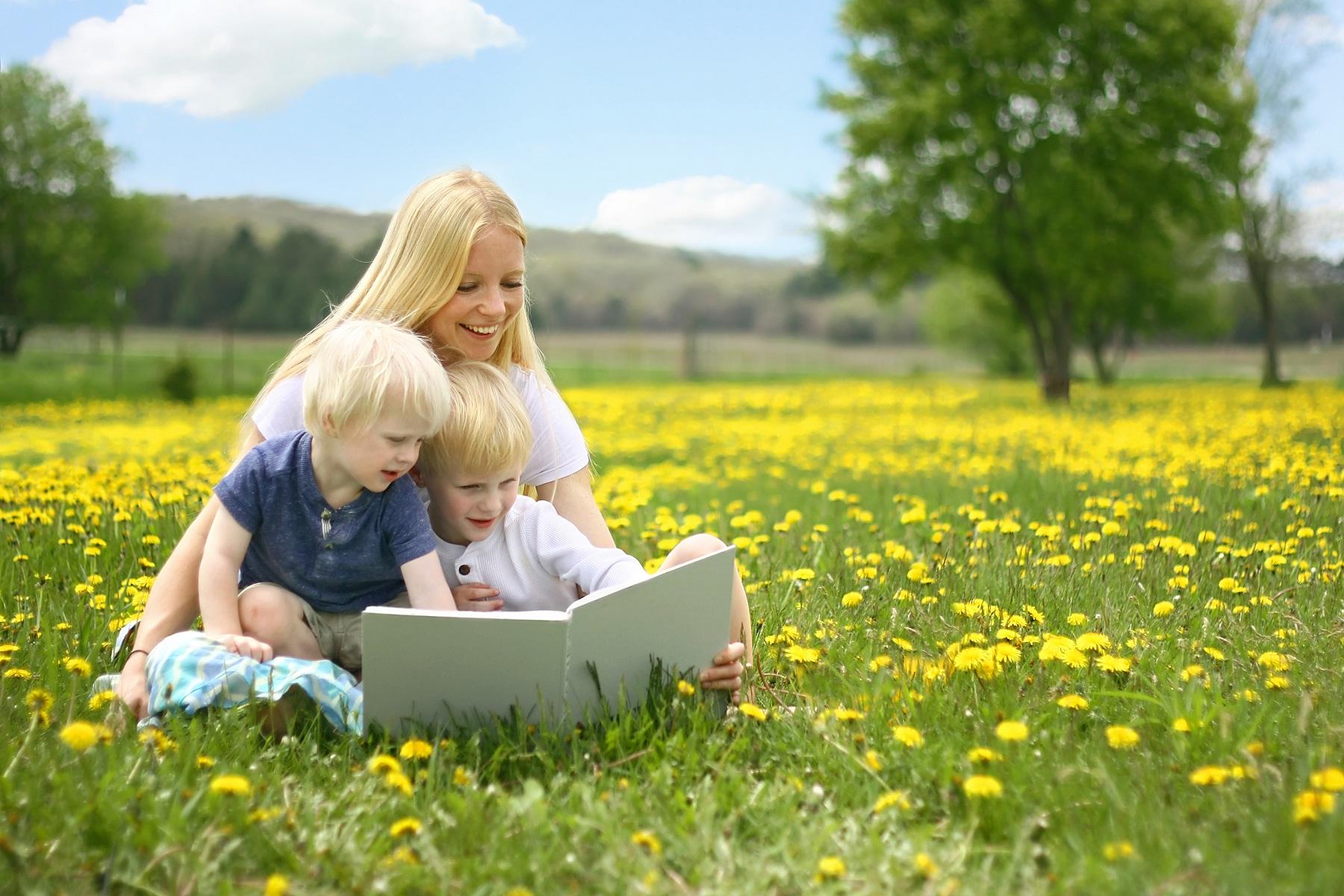Cute kids read book in garden